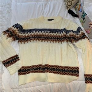 cream sweater with patterned detail
